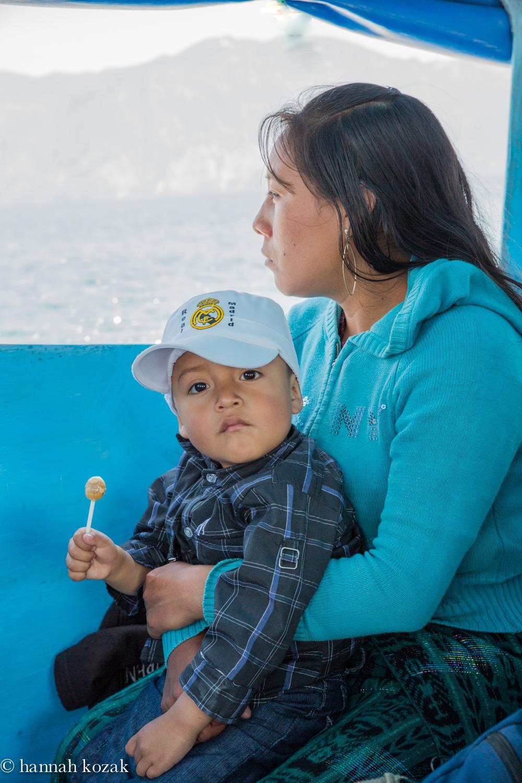 Mother & child en route to Santiago on Lake Atitlán, Guatemala
